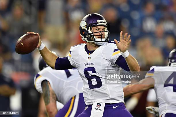 Quarterback Taylor Heinicke of the Minnesota Vikings looks for a receiver during a NFL pre-season game against the Tennessee Titans at Nissan Stadium...