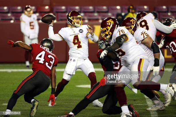 Quarterback Taylor Heinicke of the Washington Football Team passes during the 1st quarter of the game against the Tampa Bay Buccaneers at FedExField...