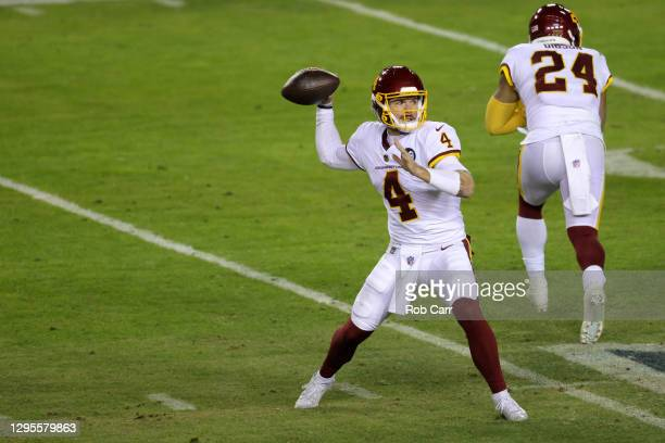 Quarterback Taylor Heinicke of the Washington Football Team passes against the Tampa Bay Buccaneers during the first half of the NFC Wild Card...