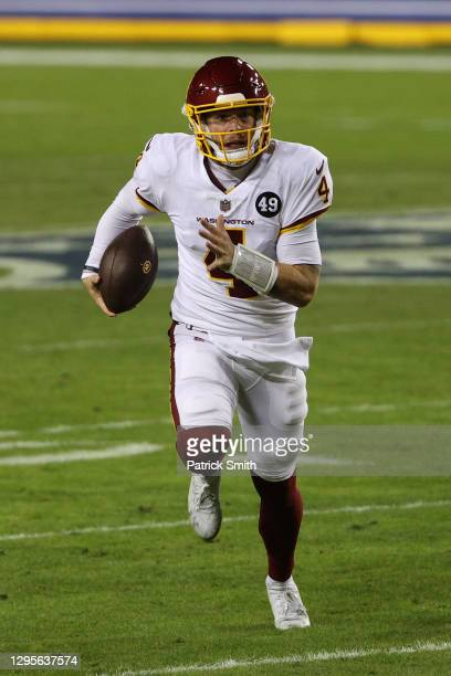 Quarterback Taylor Heinicke of the Washington Football Team rushes against the Tampa Bay Buccaneers at FedExField on January 09, 2021 in Landover,...