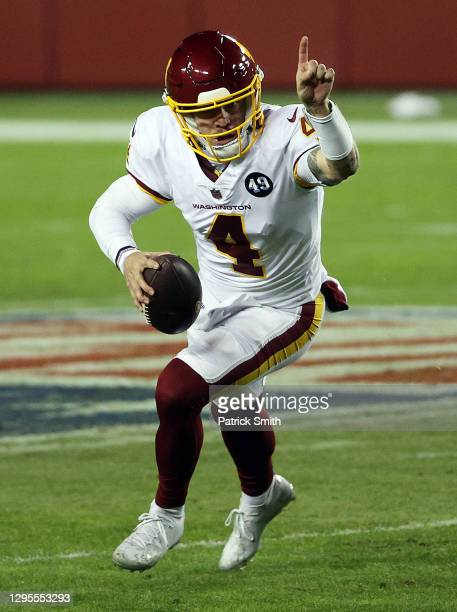 Quarterback Taylor Heinicke of the Washington Football Team scrambles during the 2nd quarter of the game against the Tampa Bay Buccaneers at...