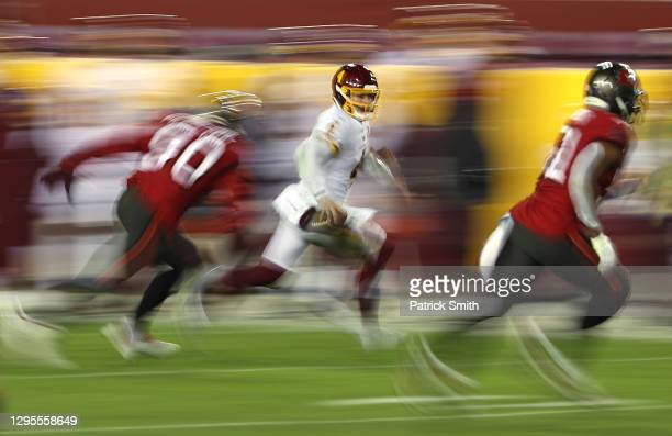 Quarterback Taylor Heinicke of the Washington Football Team scrambles during the 3rd quarter of the game against the Tampa Bay Buccaneers at...