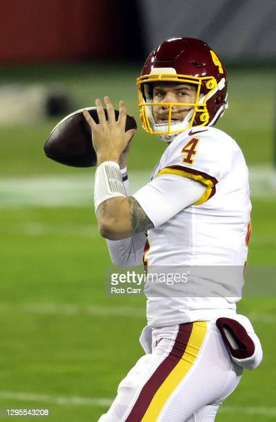 Quarterback Taylor Heinicke of the Washington Football Team warms up prior to the game against the Tampa Bay Buccaneers at FedExField on January 09,...