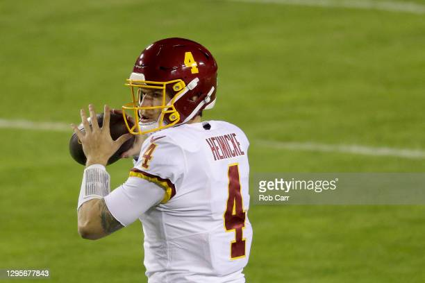 Quarterback Taylor Heinicke of the Washington Football Team warms up before the start of their game against the Tampa Bay Buccaneers during the first...