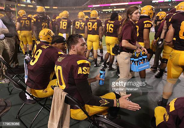 Quarterback Taylor Kelly of the Arizona State Sun Devils sits on the sidelines during the college football game against the Sacramento State Hornets...
