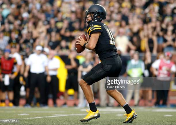 Quarterback Taylor Lamb of the Appalachian State Mountaineers looks for a receiver during the third quarter of an NCAA football game against the Wake...