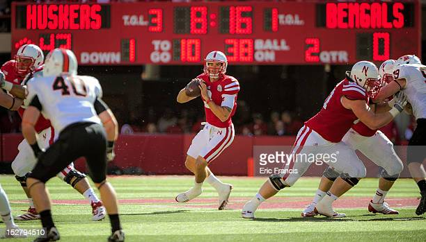 Quarterback Taylor Martinez of the Nebraska Cornhuskers looks down field over the Idaho State Bengals during their game at Memorial Stadium on...