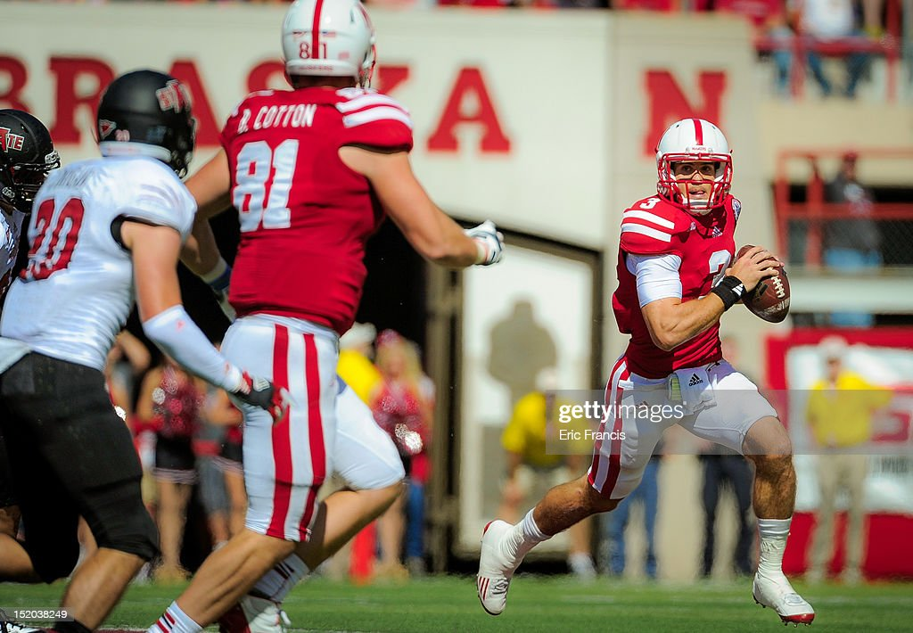 Quarterback Taylor Martinez #3 of the Nebraska Cornhuskers looks to throw to teammate tight end Ben Cotton #81 during their game against the Arkansas State Red Wolves at Memorial Stadium on September 15, 2012 in Lincoln, Nebraska.