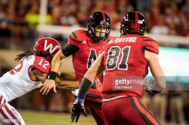 Quarterback Taylor Martinez of the Nebraska Cornhuskers runs against defensive back Dezmen Southward of the Wisconsin Badgers at Memorial Stadium on...