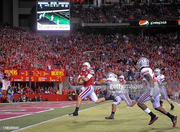 Quarterback Taylor Martinez of the Nebraska Cornhuskers scores a touchdown against the Ohio State Buckeyes during their game at Memorial Stadium...