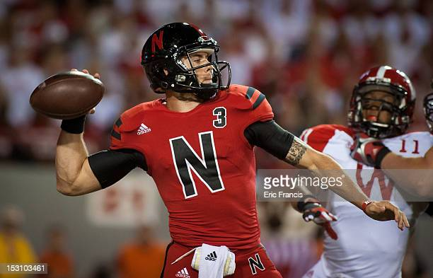 Quarterback Taylor Martinez of the Nebraska Cornhuskers throws the ball down field against the Wisconsin Badgers during their game at Memorial...