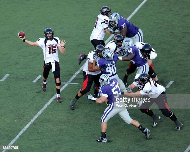 Quarterback Taylor Potts of the Texas Tech Red Raiders throws the ball down field against pressure from the Kansas State Wildcats defense in the...