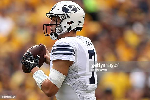 Quarterback Taysom Hill of the Brigham Young Cougars looks to pass against the West Virginia Mountaineers during the first half at FedExField on...