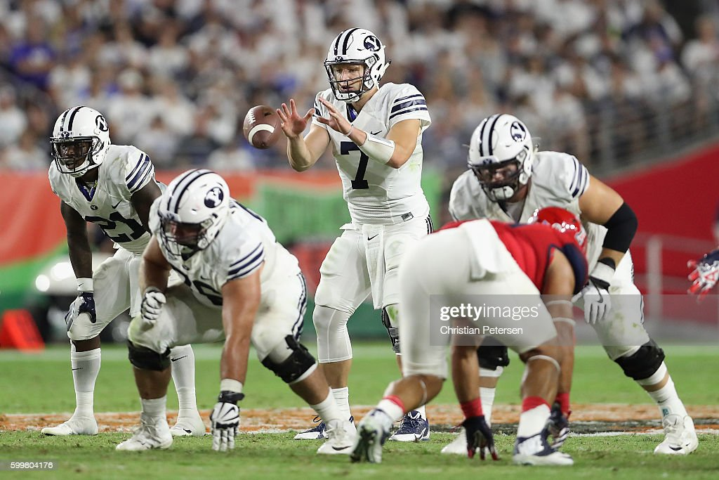 Quarterback Taysom Hill #7 of the Brigham Young Cougars snaps the football during the college football game against the Arizona Wildcats at University of Phoenix Stadium on September 3, 2016 in Glendale, Arizona. The Cougars defeated the Wildcats 18-16.