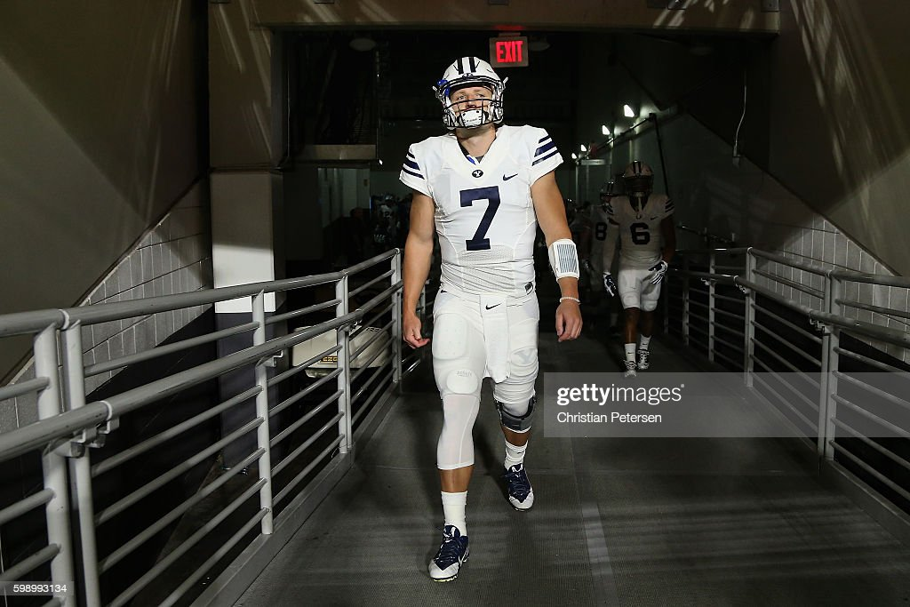 Quarterback Taysom Hill #7 of the Brigham Young Cougars walks out onto the field before the college football game against the Arizona Wildcats at University of Phoenix Stadium on September 3, 2016 in Glendale, Arizona.