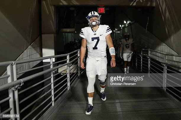 Quarterback Taysom Hill of the Brigham Young Cougars walks out onto the field before the college football game against the Arizona Wildcats at...
