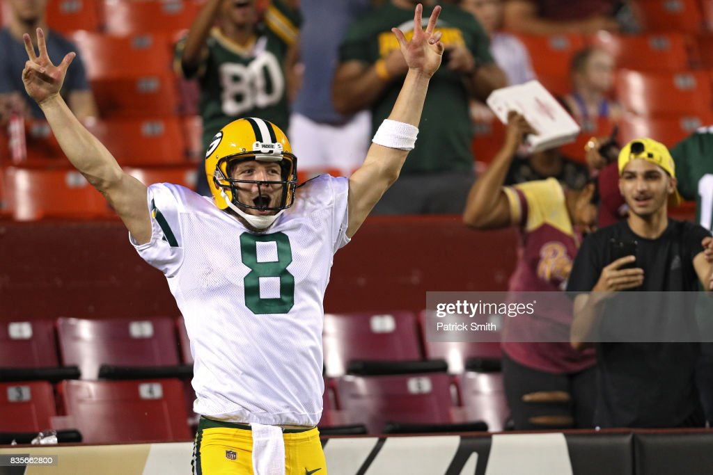 Quarterback Taysom Hill #8 of the Green Bay Packers celebrates after rushing for a touchdown against the Washington Redskins in the fourth quarter during a preseason game at FedExField on August 19, 2017 in Landover, Maryland.