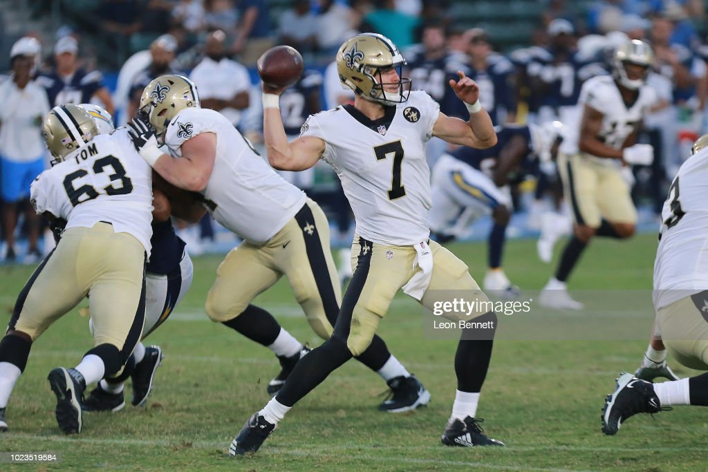 Quarterback Taysom Hill #7 of the New Orleans Saints passes the ball against the Los Angeles Chargers during a preseason NFL game at StubHub Center on August 25, 2018 in Carson, California.