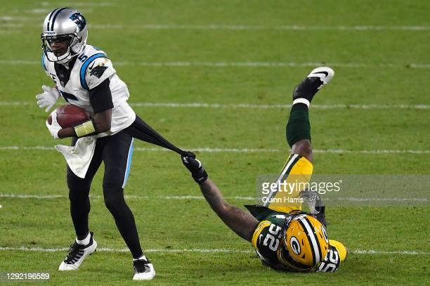 Quarterback Teddy Bridgewater of the Carolina Panthers is tackled by linebacker Rashan Gary of the Green Bay Packers in the fourth quarter of the...