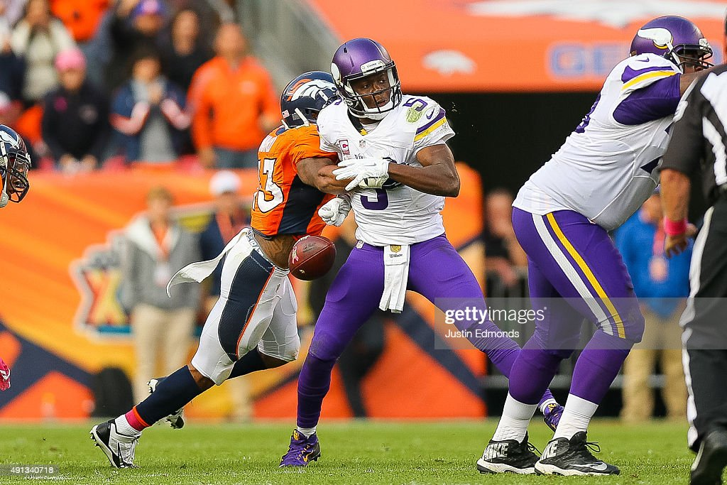 Quarterback Teddy Bridgewater #5 of the Minnesota Vikings has the ball stripped by strong safety T.J. Ward #43 of the Denver Broncos to end the game in favor of the Denver Broncos by a score of 23-20 at Sports Authority Field at Mile High on October 4, 2015 in Denver, Colorado.