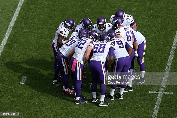 Quarterback Teddy Bridgewater of the Minnesota Vikings huddles the offense against the Denver Broncos at Sports Authority Field at Mile High on...