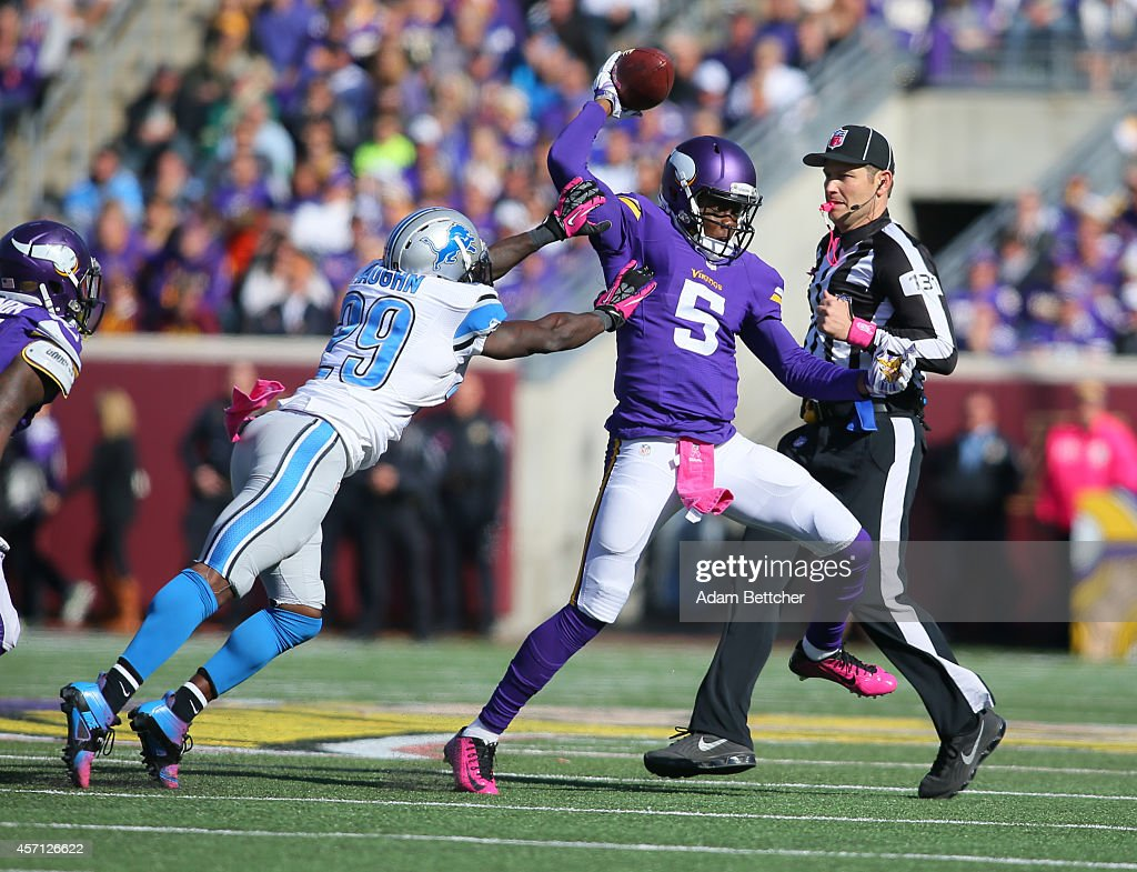Quarterback Teddy Bridgewater #5 of the Minnesota Vikings scrambles against Cassius Vaughn #29 of the Detroit Lions on the line during the fourth quarter on October 12, 2014 at TCF Bank Stadium in Minneapolis, Minnesota.