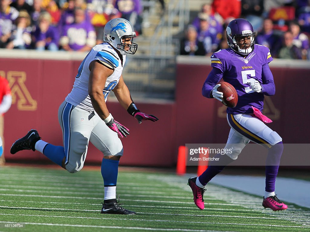 Quarterback Teddy Bridgewater #5 of the Minnesota Vikings scrambles against Ndamukong Suh #90 of the Detroit Lions during the fourth quarter on October 12, 2014 at TCF Bank Stadium in Minneapolis, Minnesota.