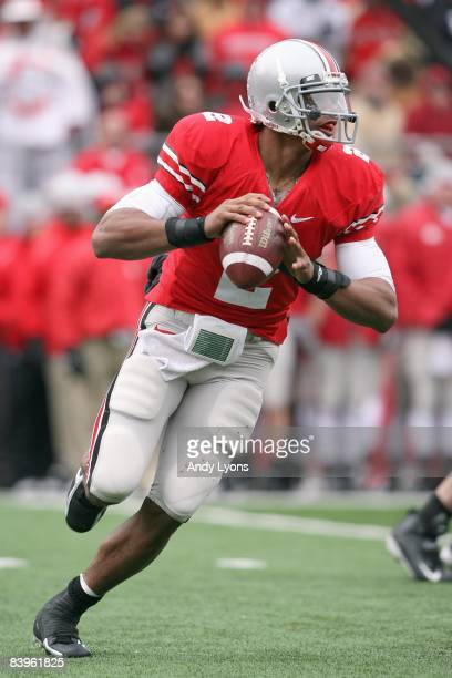 Quarterback Terrelle Pryor of the Ohio State Buckeyes moves to pass the ball during the Big Ten Conference game against the Michigan Wolverines at...