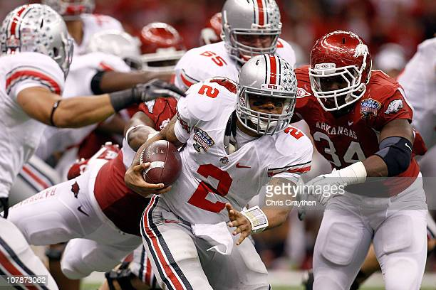 Quarterback Terrelle Pryor of the Ohio State Buckeyes runs the ball against Jerry Franklin of the Arkansas Razorbacks in the fourth quarter during...