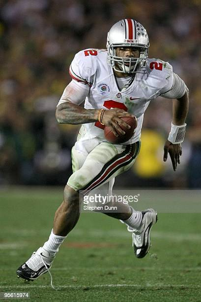 Quarterback Terrelle Pryor of the Ohio State Buckeyes runs with the ball against the Oregon Ducks during the 96th Rose Bowl game on January 1 2010 in...