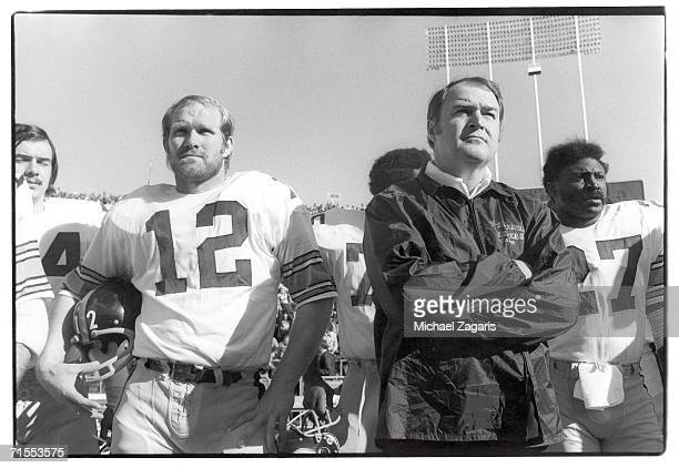 Quarterback Terry Bradshaw and head coach Chuck Noll of the Pittsburgh Steelers stand on the sideline during the 1974 AFC Championship Game against...