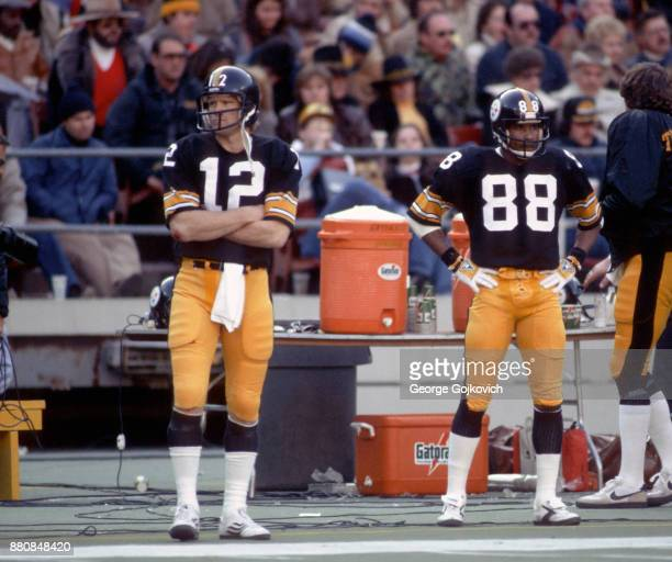 Quarterback Terry Bradshaw and wide receiver Lynn Swann of the Pittsburgh Steelers look on from the sideline during a National Football League game...