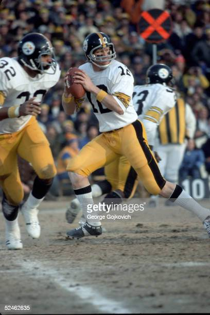 Quarterback Terry Bradshaw of the Pittsburgh Steelers drops back to pass during the AFC Divisional Playoff game against the Baltimore Colts on...
