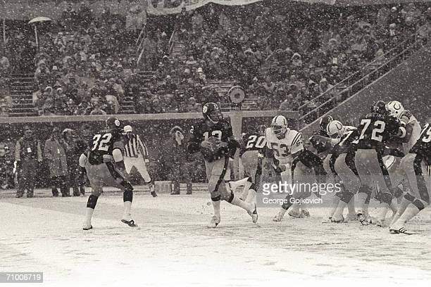Quarterback Terry Bradshaw of the Pittsburgh Steelers drops back to pass as snow falls during a game against the Baltimore Colts at Three Rivers...