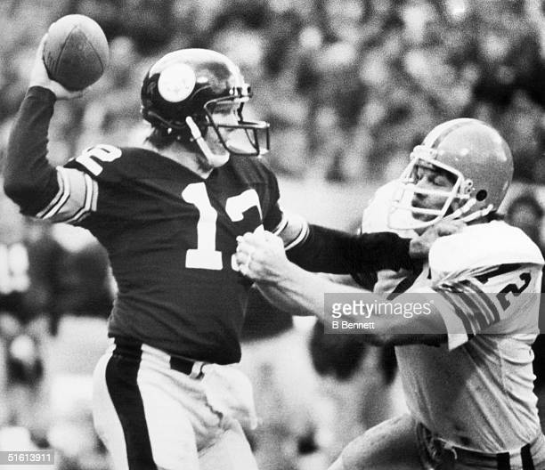 Quarterback Terry Bradshaw of the Pittsburgh Steelers gets a pass off despite pressure from defensive tackle Jerry Sherk of the Cleveland Browns...