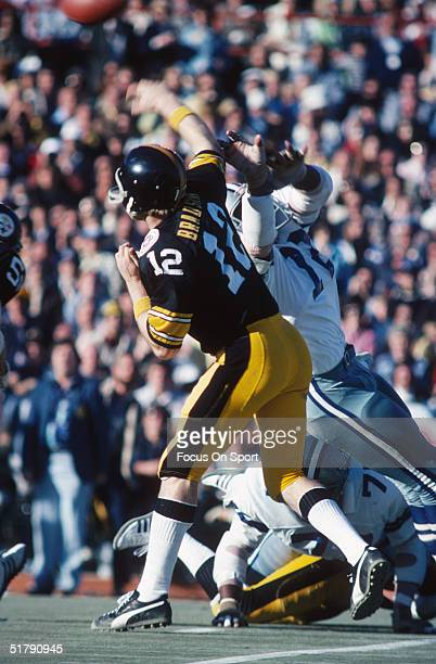 Quarterback Terry Bradshaw of the Pittsburgh Steelers passes under the pressure of the Dallas Cowboys defense during Super Bowl X at the Orange Bowl...