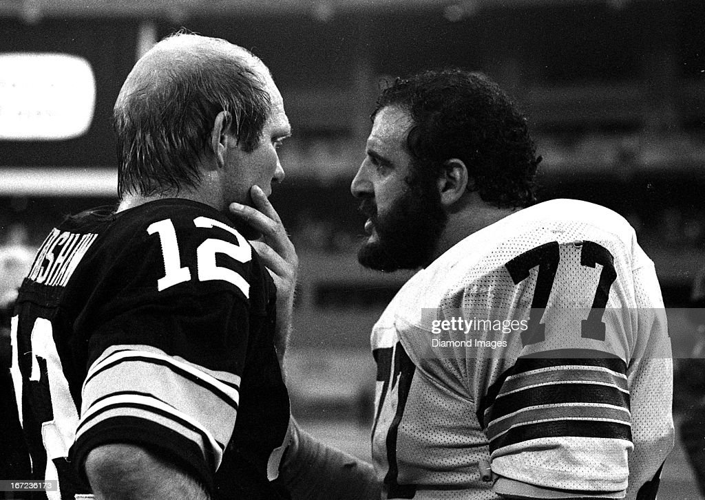 Quarterback Terry Bradshaw #12 of the Pittsburgh Steelers talks with defensive tackle Lyle Alzado #77 of the Cleveland Browns following a game on Sunday Novembet 16, 1980 at Three Rivers Stadium in Pittsburgh, Pennsylvania. Pittsburgh won 16-13.