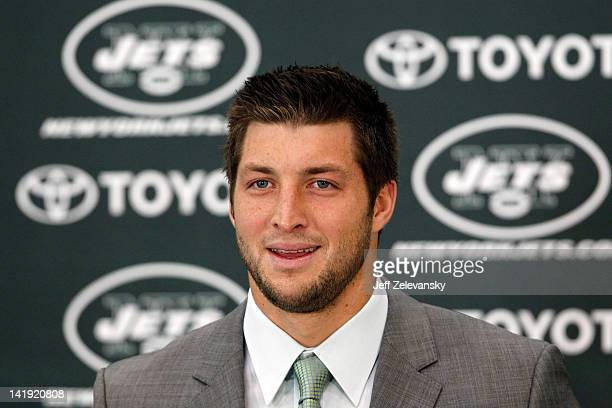 Quarterback Tim Tebow addresses the media as he is introduced as a New York Jet at the Atlantic Health Jets Training Center on March 26 2012 in...