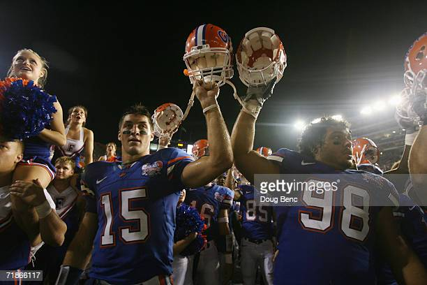 Quarterback Tim Tebow and Clint McMillan of the University of Florida Gators celebrate with teammates during the game against the University of...