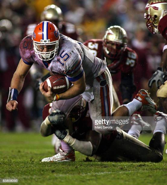 Quarterback Tim Tebow is brought down by the Florida State Seminoles at Bobby Bowden Field at Doak Campbell Stadium on November 29, 2008 in...