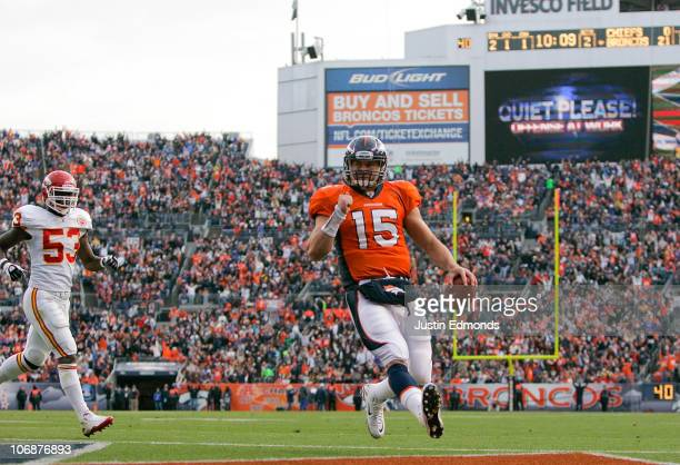 Quarterback Tim Tebow of the Denver Broncos scores on a 1yard touchdown run as linebacker Demorrio Williams of the Kansas City Chiefs gives chase...