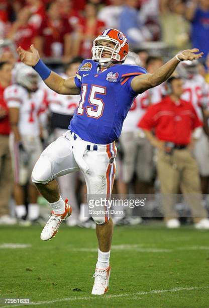 Quarterback Tim Tebow of the Florida Gators celebrates after throwing a 1 yard touchdown reception against the Ohio State Buckeyes during the second...