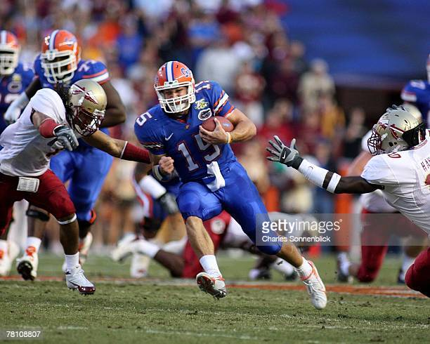 Quarterback Tim Tebow of the Florida Gators cuts through the middle of the field for a first down during the game against the Florida State Seminoles...