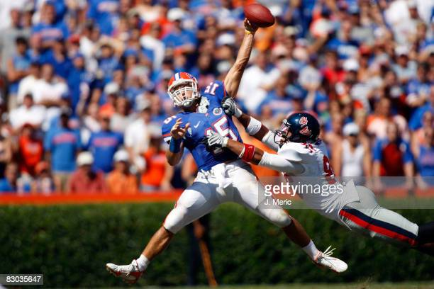 Quarterback Tim Tebow of the Florida Gators is hit by defensive end Greg Hardy of the Mississippi Rebels during the game on September 27, 2008 at Ben...