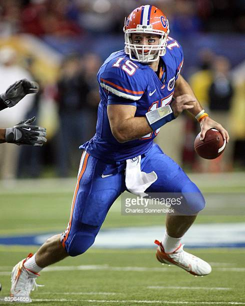 Quarterback Tim Tebow of the Florida Gators looks for an open receiver against the Alabama Crimson Tide during the game at the Georgia Dome on...