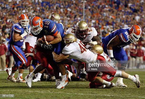 Quarterback Tim Tebow of the Florida Gators looks for some yardage during the game of the Florida State Seminoles on November 24, 2007 at Ben Hill...