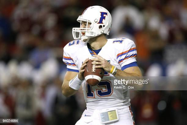 Quarterback Tim Tebow of the Florida Gators looks to pass against the Alabama Crimson Tide during the SEC Championship game at Georgia Dome on...