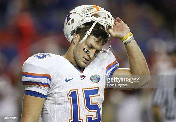 Quarterback Tim Tebow of the Florida Gators reacts after he threw an interception in the redzone in the fourth quarter against the Alabama Crimson...