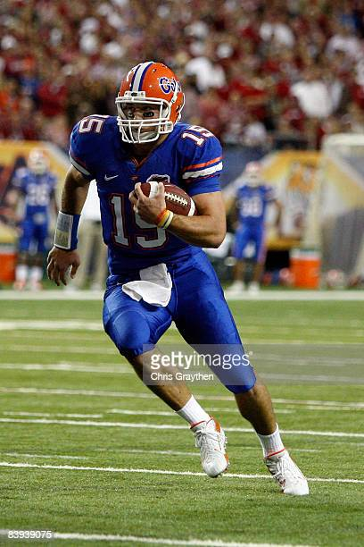 Quarterback Tim Tebow of the Florida Gators runs against the Alabama Crimson Tide during the SEC Championship on December 6 2008 at the Georgia Dome...