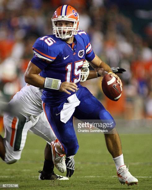 Quarterback Tim Tebow of the Florida Gators runs for a first down against the Miami Hurricanes on August 30 2008 at Ben Hill Griffin Stadium in...
